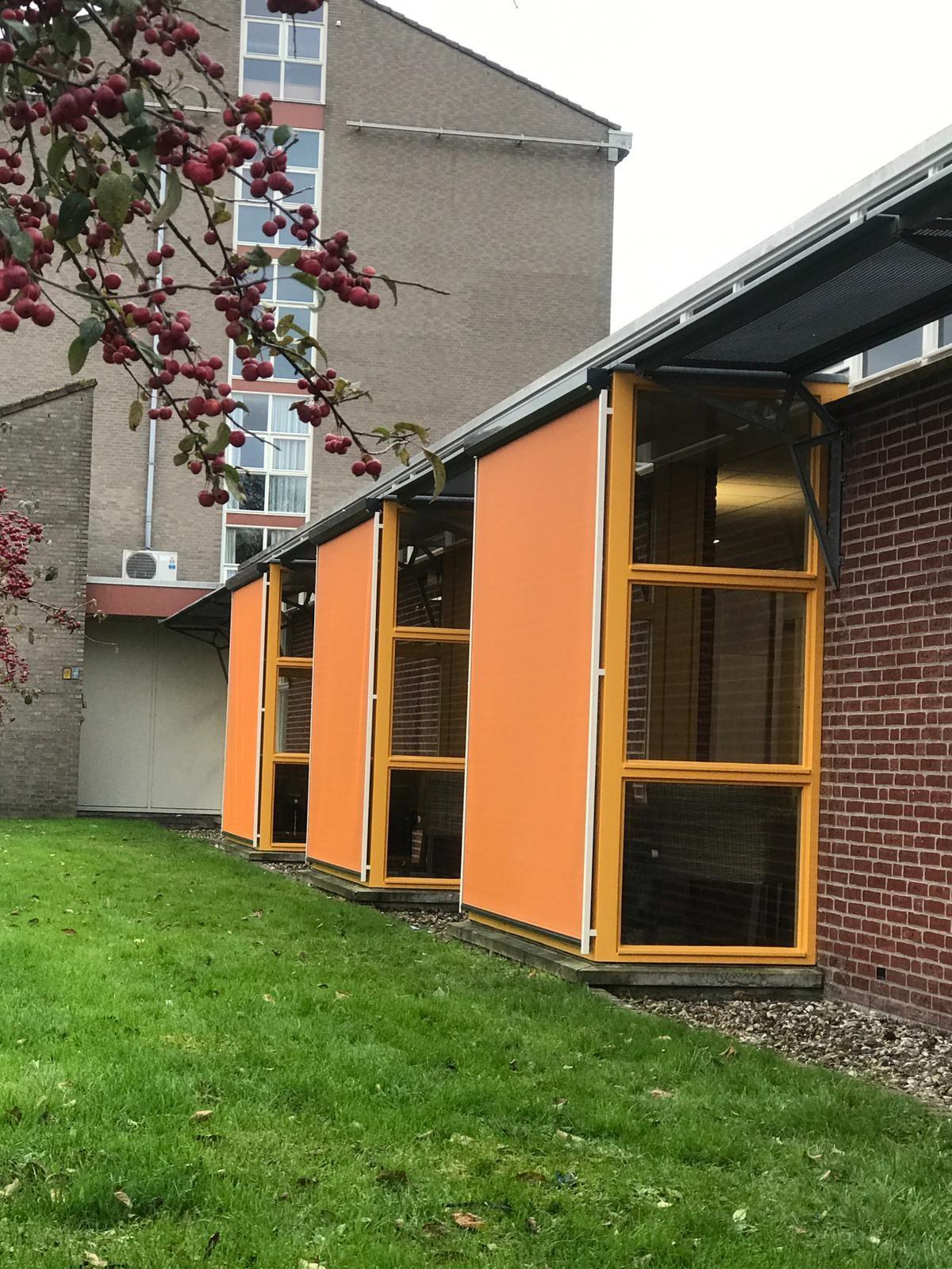 Van Ewijk Zonwering Projectzonwering en Coloriet De Regenboog Dronten