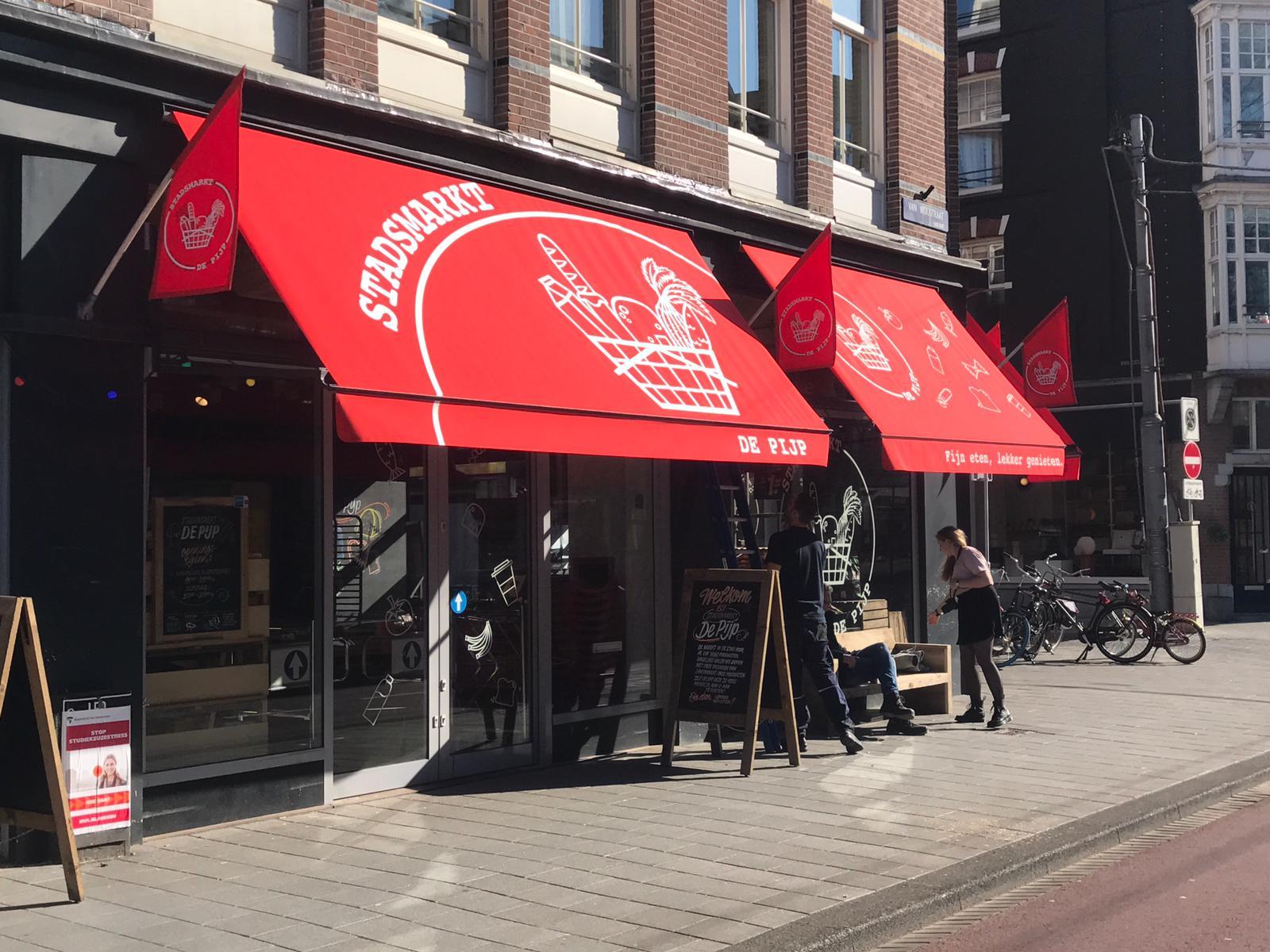 Van Ewijk Zonwering Projectzonwering en supermarkt Amsterdam