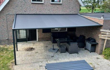 Veranda terras zonnescherm op poten op maat bij Van Ewijk Zonwering in Lelystad Dronten Swifterbant Biddinghuizen en Almere